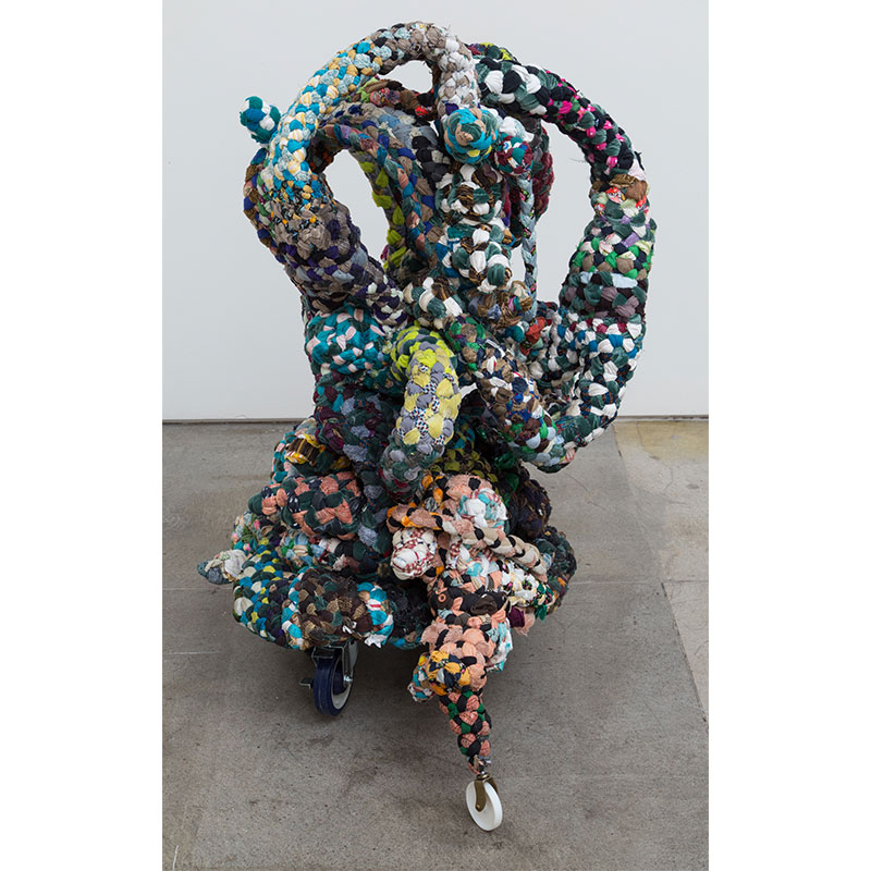 """Janitor, Banker, Subway , 2016 donated fabric, thread, wheels, epoxy resin 45 x 30 x 28""""  Inquire >"""