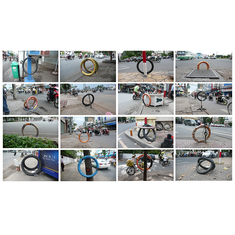 "Bicycle Repair Signals , 2009 16 digital prints on photographic paper 23.5 x 41"" each framed 97 x 167"" installed  Inquire >"