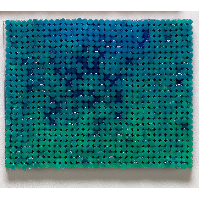 "Blue on Green , 2018-19 cigarette filters, resin and ink 8.75 x 11 x 1.5""  Inquire >"