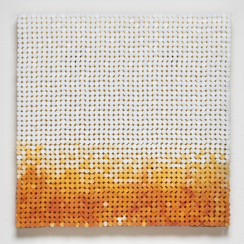 "Sunset: Yellow , 2018-19 cigarette filters, resin and ink 14 x 14 x 1.5""  Inquire >"