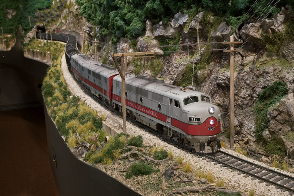 A trio of F3s leads a coal extra through the river gorge.