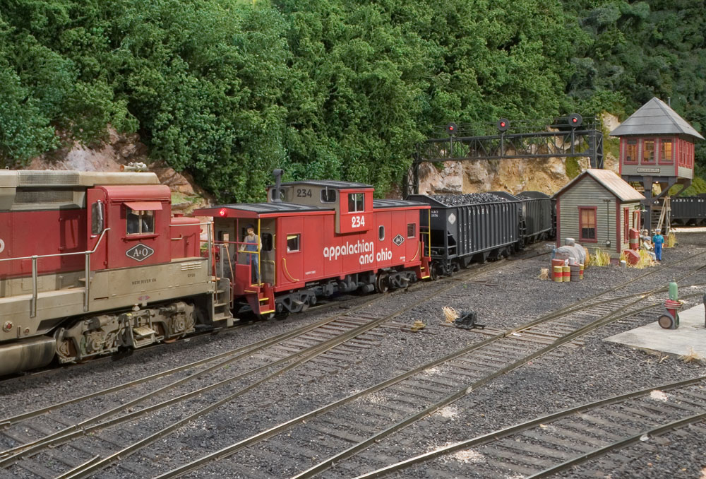GP30 #410 is added to the rear of a coal extra as it exits the Willow Creek yard.
