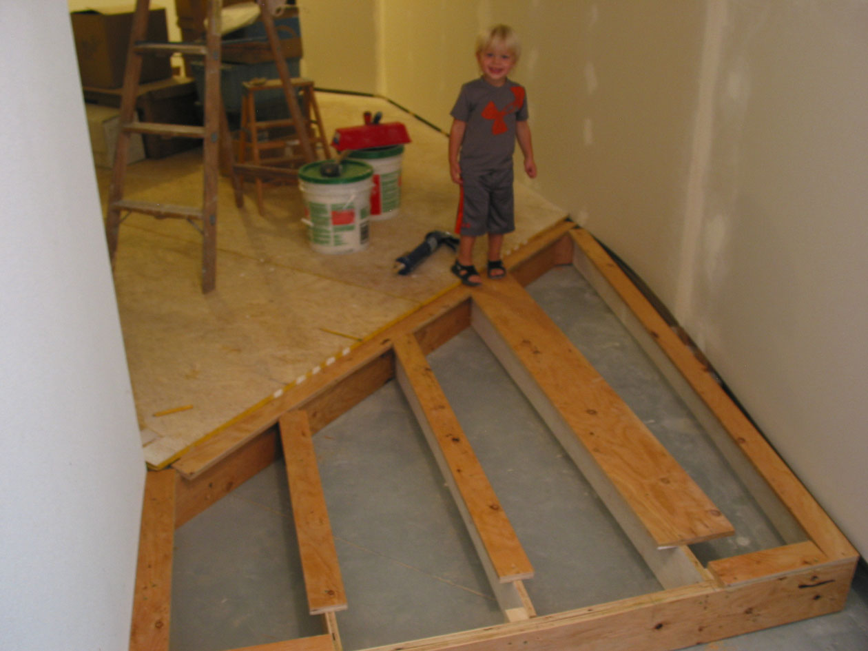 With the walls in place, I could add the additional elevated floor necessary for entrance into Ridge. Today I am assisted by grandson Jett.