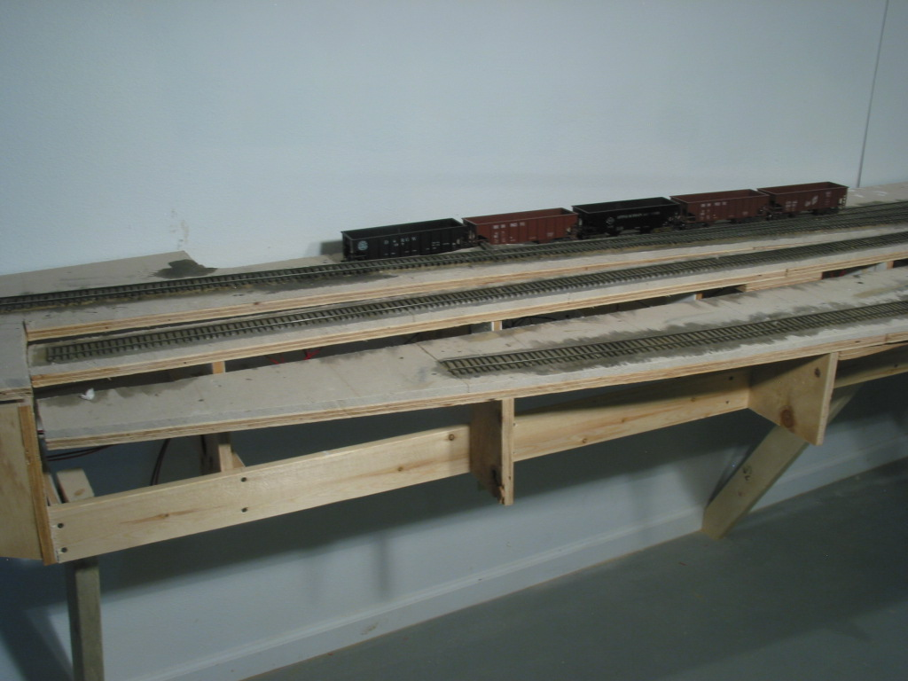 "The ""Springs"" features the ""Cookie-Cutter"" style framing for the various track levels. The A&O and NR&W mains drop a consistent 2% the length of the scene with the diverging tracks returning to level."