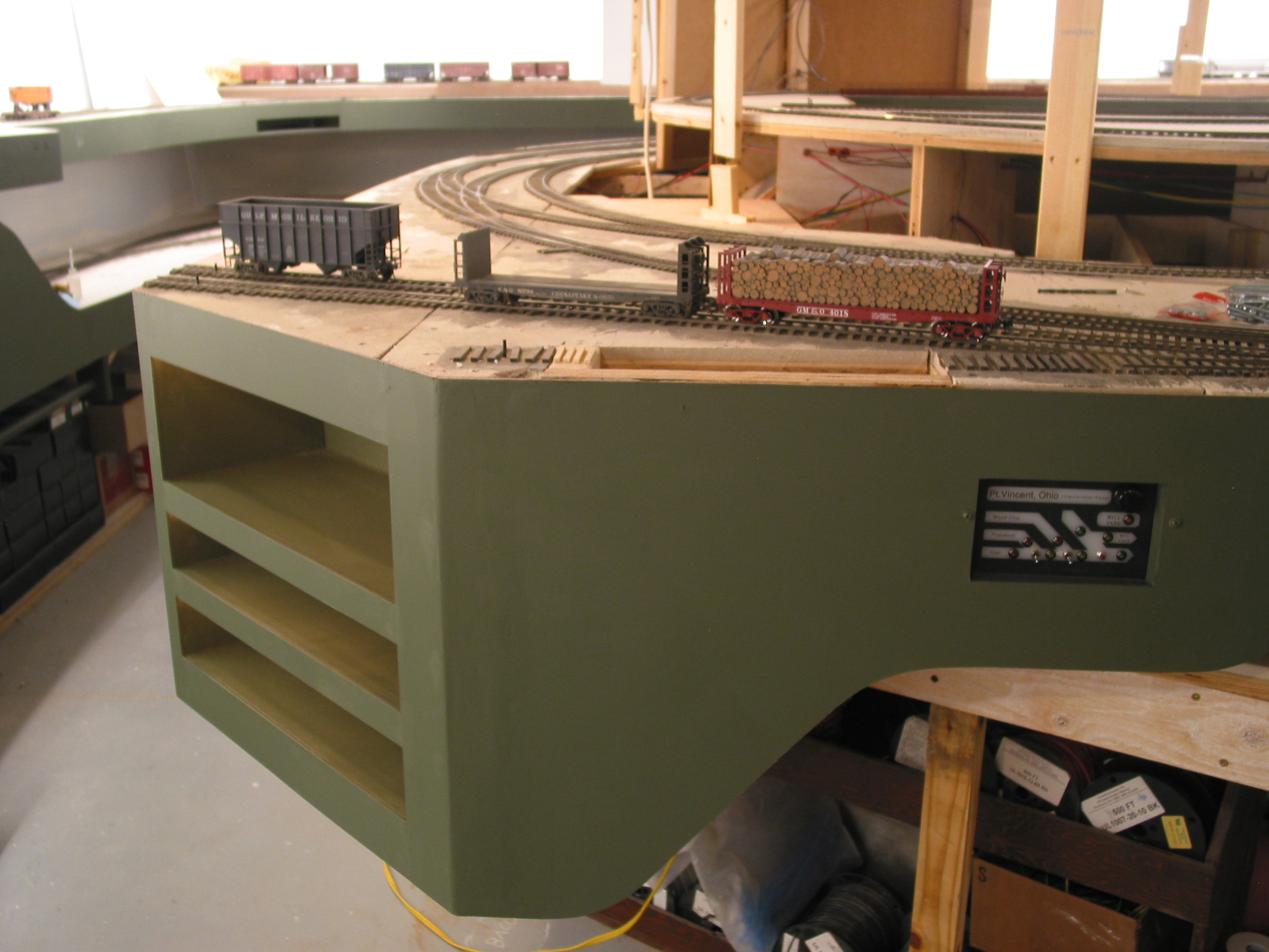 The finished Pt. Vincent work station with its removed-loads cubbies (lower two) and card file shelf (top). Rope lighting for night ops lights each one. Effort on the fascia helps provide a shadow-box effect for the railroad.