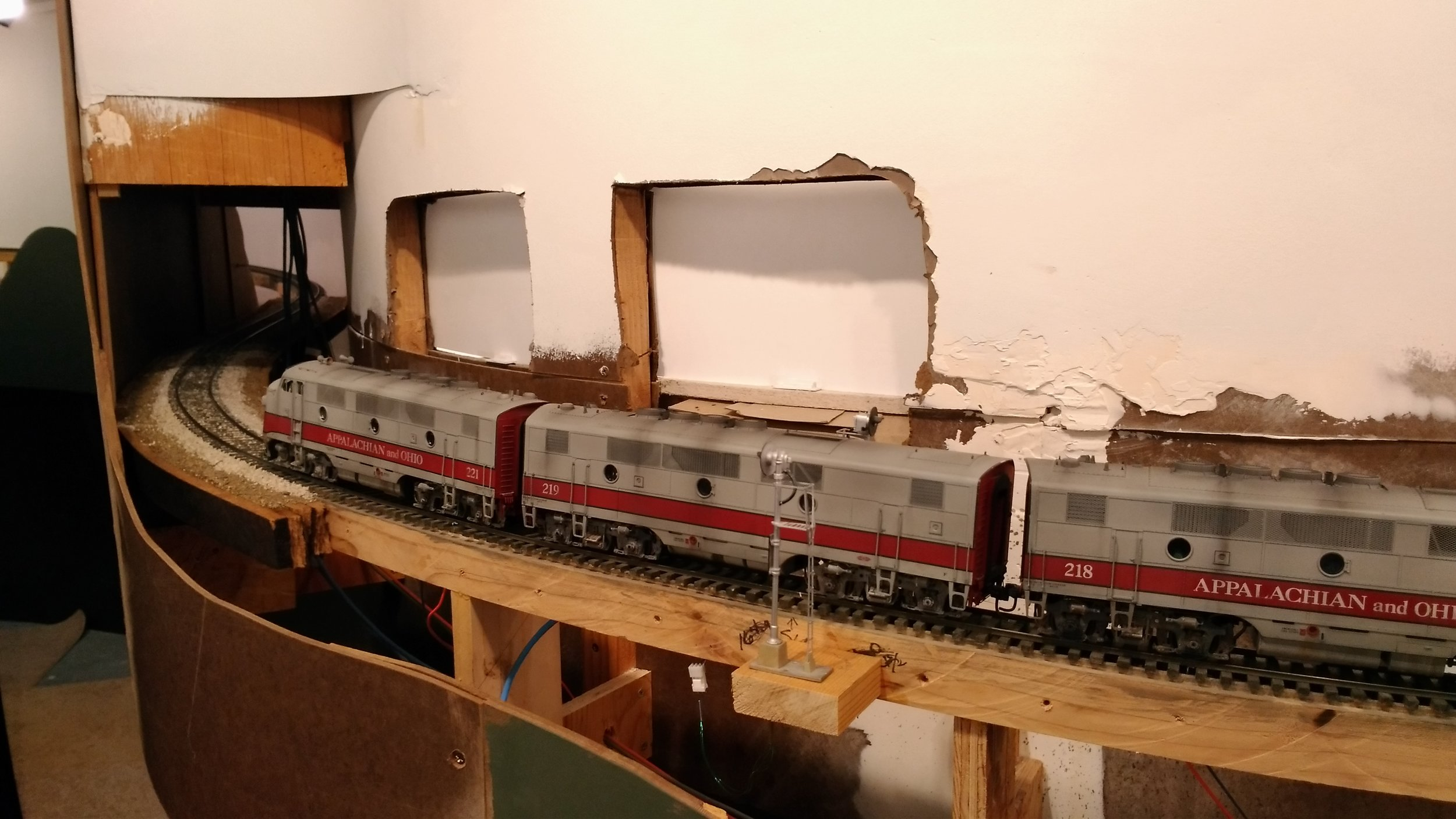 Typical of mountain railroading, the mainline now dives into County Line Tunnel and a gentle reverse curve. Once the tunnel liner is installed, the fascia will get its final spackle  and paint, the last on the layout!