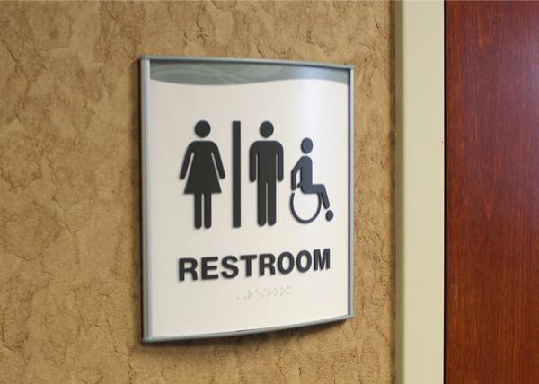 curved restroom sign ada