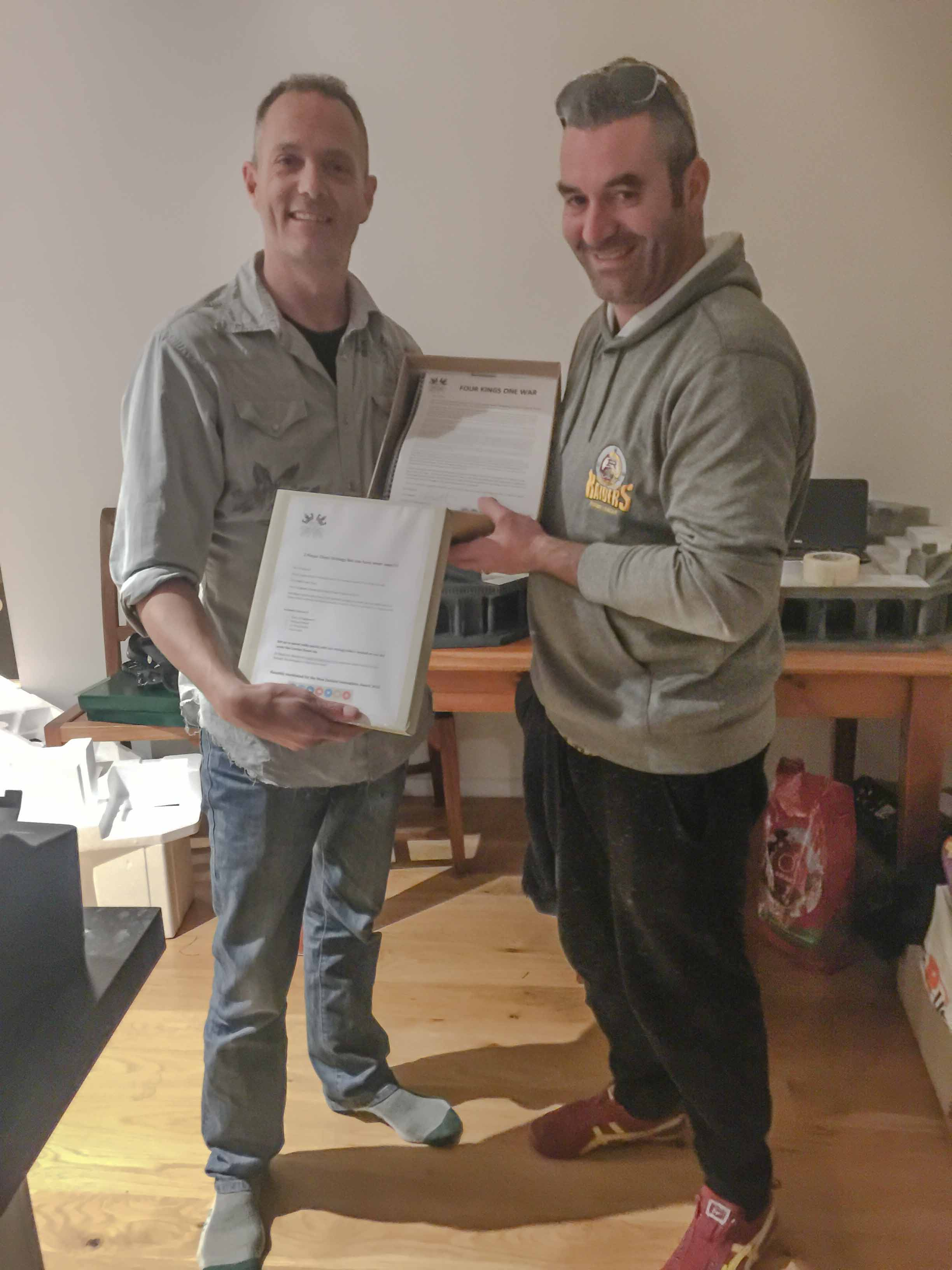 Glyn and Garth with the pieces, rules and intro letter for Richard.jpg