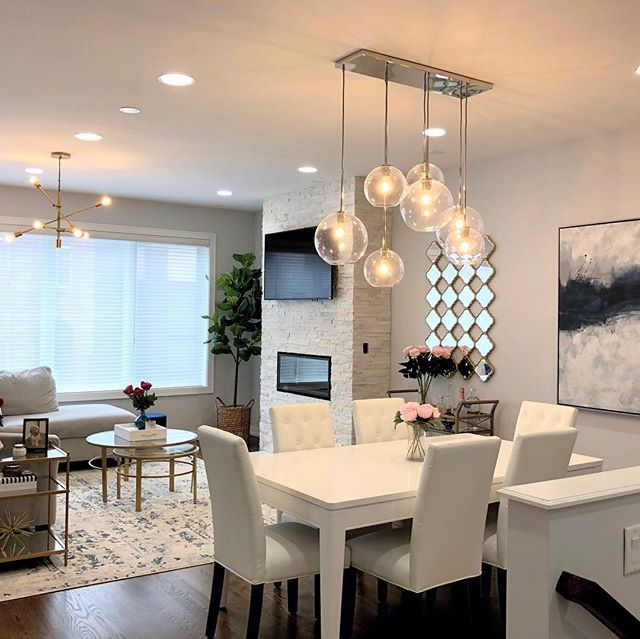 Just wrapped up this living/dining room project in West Town! We went with a contemporary style and pops of color everywhere. The biggest transformation were these amazing chandeliers from @westelm - they really elevate the space! Click the link in bio to see the entire project!