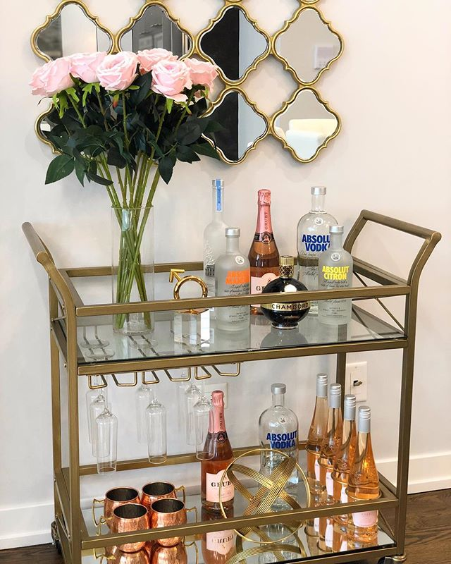 I love this bar cart that we styled for our West Town project - functional AND stylish! 🥂