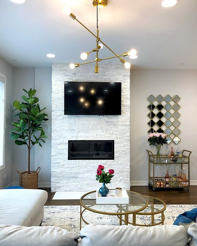 We gave this room a fresh coat of paint to brighten up the space but still allow the gorgeous fireplace to pop. Paint can make a huge difference! Swipe to see the before photo!