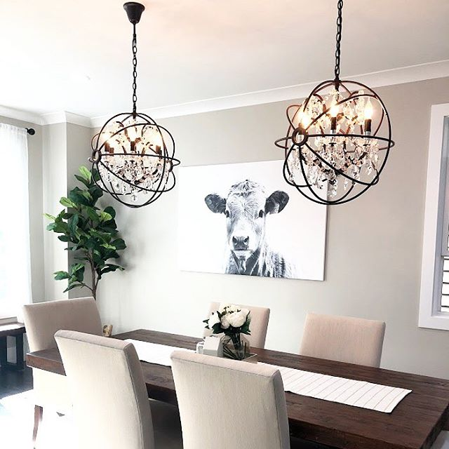 Just finished designing 8 spaces in a new construction house! This rustic dining room might be my favorite - how stunning are these chandeliers?  Design by: @whittakerinteriors