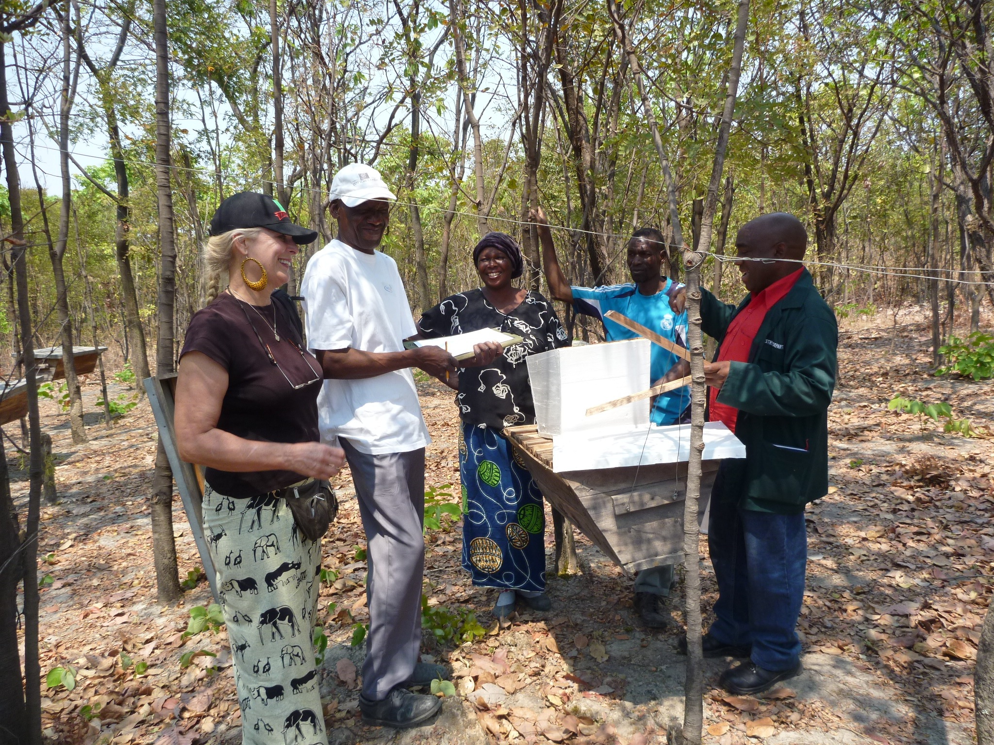 June - Bee keeping business established. Forestry Dept. was hired to train 10 villagers how to start a bee keeping business. The government donated 11 beehives, then a donation from Streetsville Rotary Clubprovided clothes, boots, and start up supplies.(blog post)