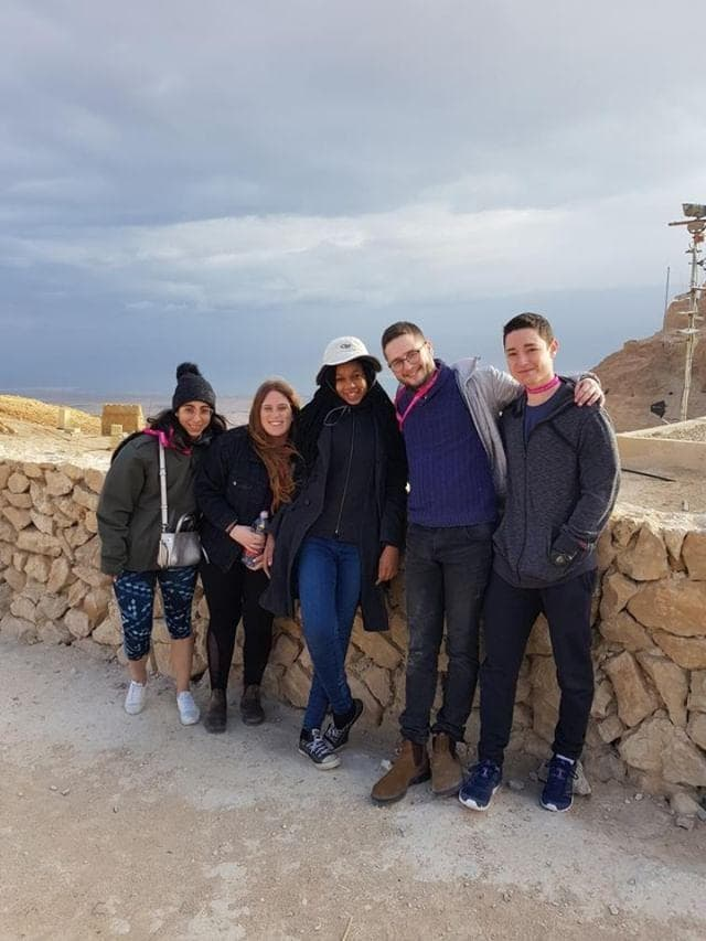 Shekhiynah with her fellow birthright participants an IDF soldiers atop of Masada