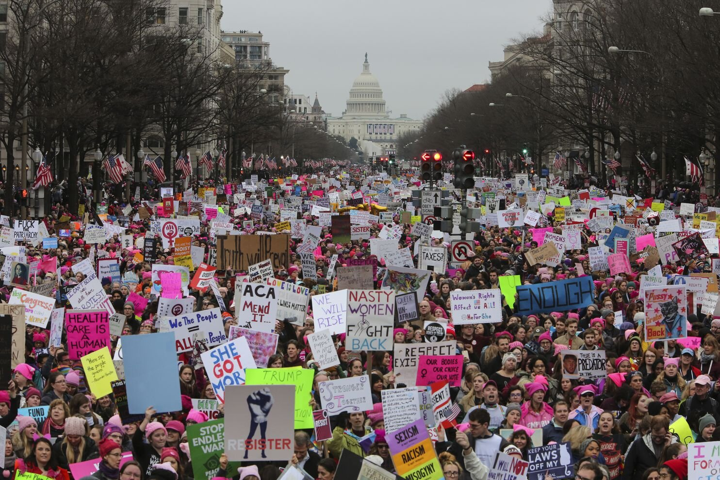 With the Capitol in the background, a crowd fills a street in the District during the Women's March on Jan. 21, 2017. (Oliver Contreras for The Washington Post)