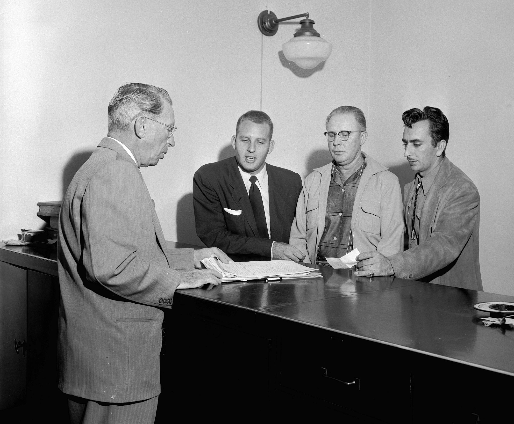 "County Clerk B.J. ""Bats"" Smith accepts some of the paperwork for the incorporation of the new City of Dairyland, 1955 (Courtesy the Orange County Archives)."