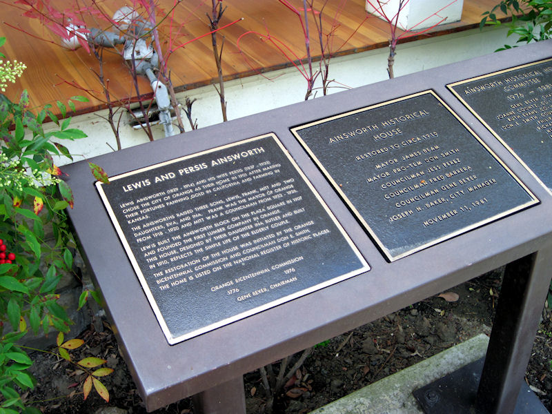 Plaques in front of the Ainsworth House (no longer owned by the city).