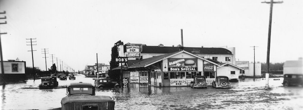 This is the only photo I have yet found of any of the hot spots out on Manchester Avenue. It was taken during the floods of 1938, looking north along Manchester about where State College comes down today. Bob's Place (or Bob's Barbecue) is on the corner. Besides burgers, malts, and chicken pies, it was sometimes busted for serving alcohol to minors.