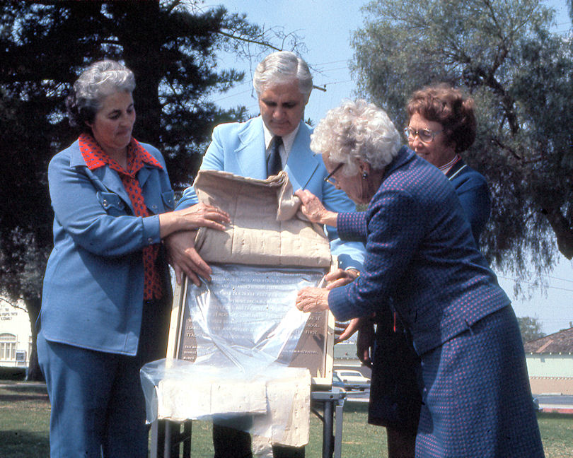 Florence Smiley, who attended classes on this site in the 1890s, unveils the plaque, March 26, 1976. Assisting are Orange Unified School District Trustee Ruth Evans, OUSD Superintendent Donald Ingwerson, and Maxine Schenck of the Association of California School Administrators. (Photo by Phil Brigandi)