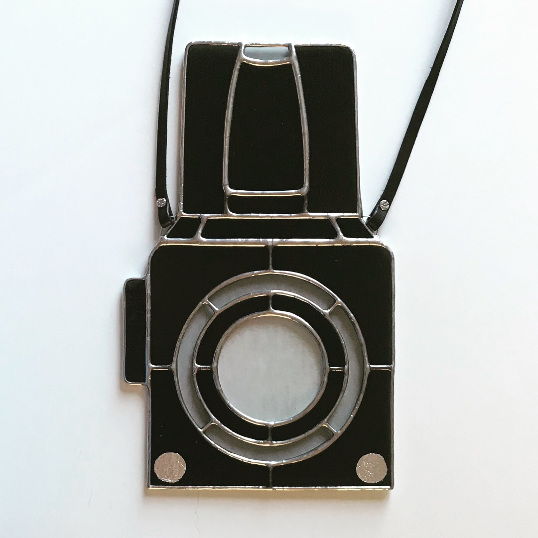 I contacted Manita Studio Works with a request for a Hasselblad stained glass camera for my husband's birthday. Working with her was so easy. She had great ideas, and helped me make all the right decisions. It turned out absolutely perfect and my husband was over the moon with it! We have it hung in his studio window, I can't imagine a better custom experience. Thank you so much! - Monica G., Santa Monica, CA
