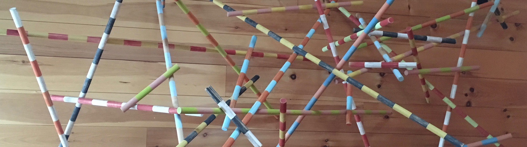 Detail of 'banded poles' by paul oberst. acrylic on wooden dowels manufactured at the mill. this sculpture is on display in the kitchen of the mill school.