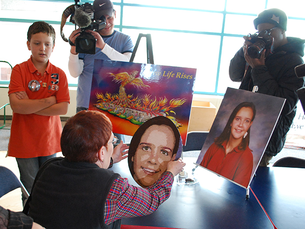 Carter Bryant looks on as the the floragraph portrait of his mother, Caroline Ball Bryan, is completed in Utah. Carter was delivered via C-section after his mother suffered head trauma in a car accident. Caroline died the following day, before saving six lives as an organ donor.