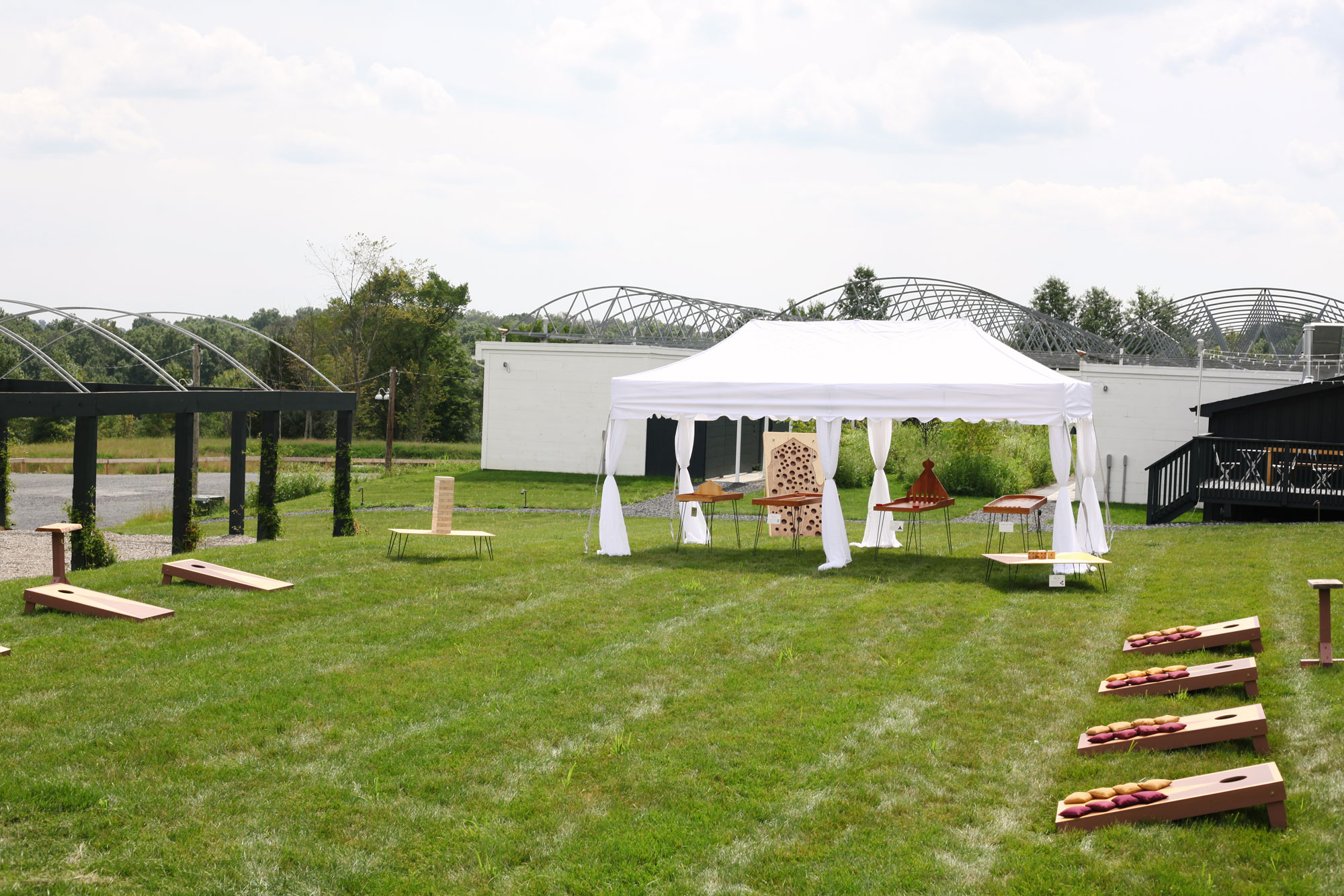 Our 10' x 20' pop-up tent comes with Game Rental Package #2 to lend much-needed shade and protection from the elements for guests enjoying our signature table games, inspired by 1500s Europe and traveling carnivals.