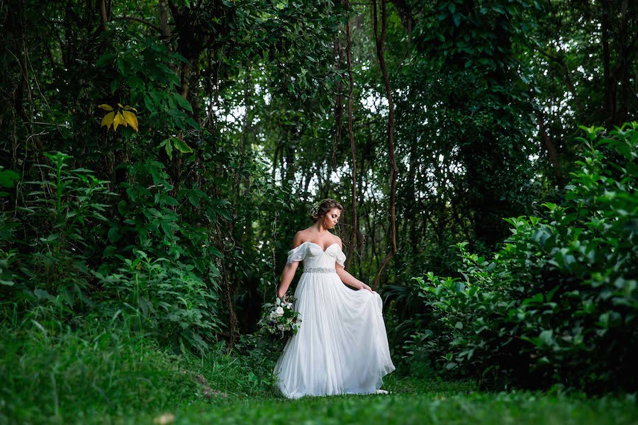 Bride wearing Amsale wedding dress from Blush Bridal Sarasota Portrait in Woods | Southern Inspired Outdoor Wedding Reception Decor Styled Shoot at Tampa Bay Wedding Venue Bakers Ranch