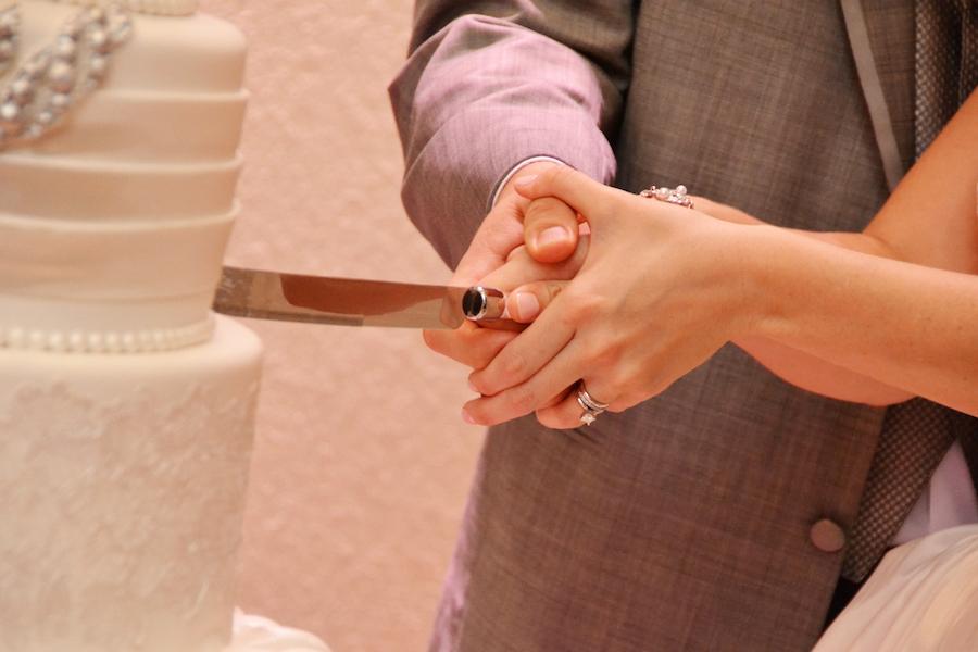 Bride and Groom Cake Cutting at Wedding Reception   Sarasota Wedding Indoor Reception