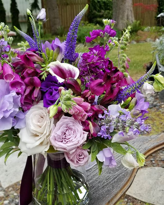 Lavender love! Bridal bouquet with roses, veronica, sweet peas, foxglove, stock, & calla lilies. #Botanikal #bellinghamflorist #weddingflowers