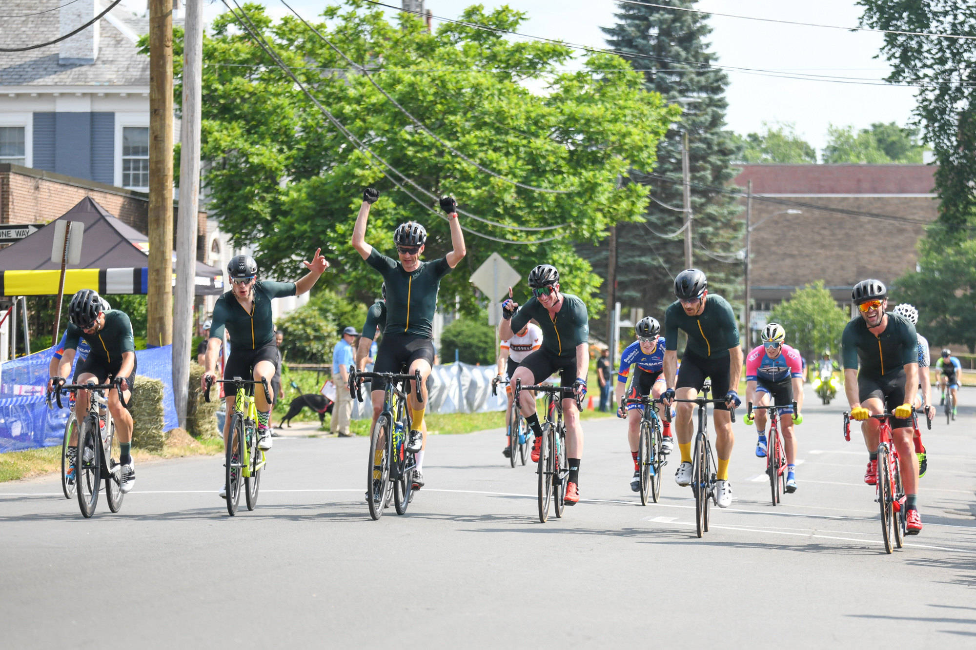 After lapping the field twice in one of the most bananas races we have ever seen, Kevin Bouchard-Hall rolled in for a celebratory win with the rest of his Velocio Northeast teammates