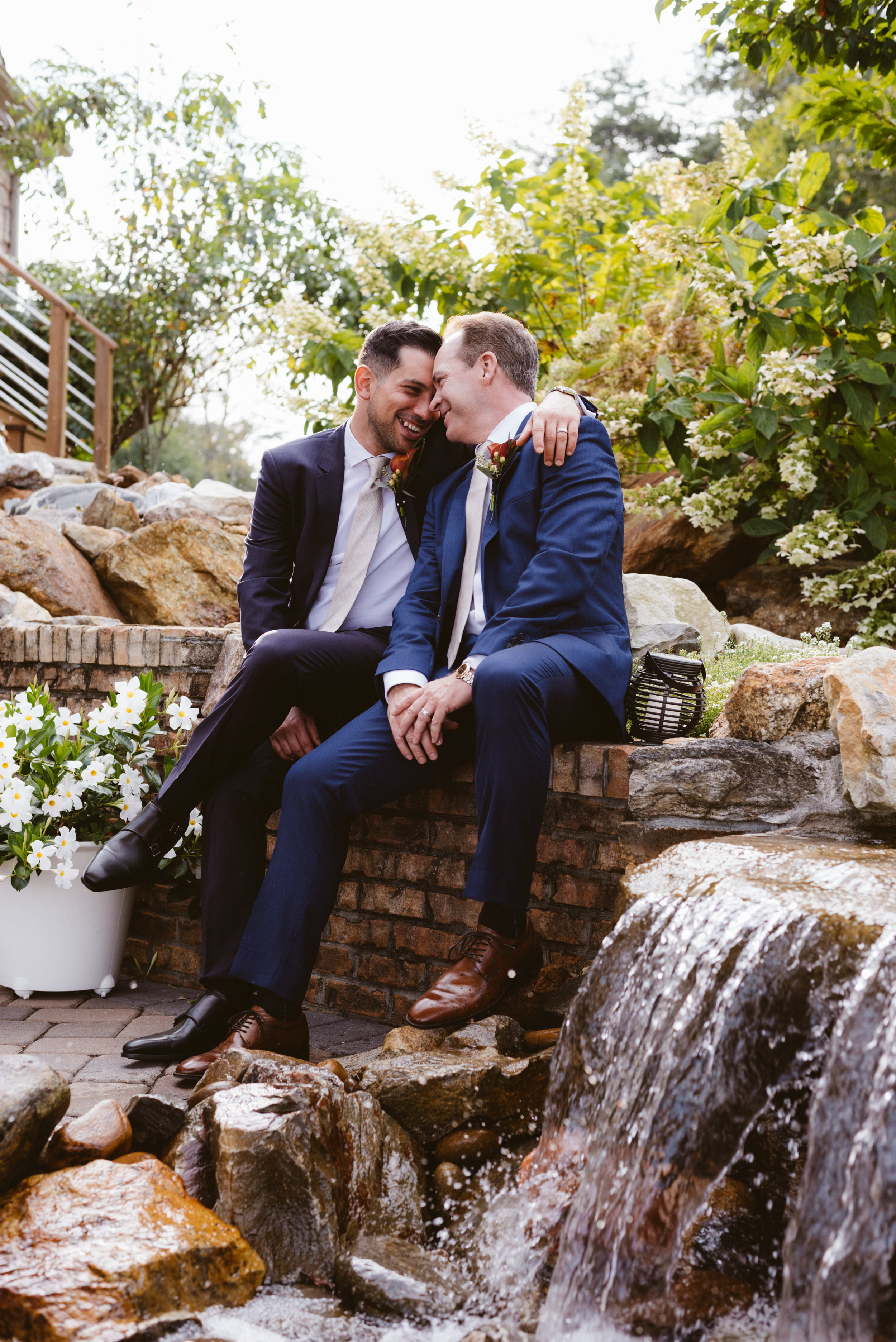 GROOM AND GROOM toasting DURING THEIR BEAUTIFUL ELOPEMENT IN THE BLUE RIDGE MOUNTAINS OF ASHEVILLE, NORTH CAROLINA. music and sound provided by LGBTQ supporter and Wedding Musician & DJ in Asheville.
