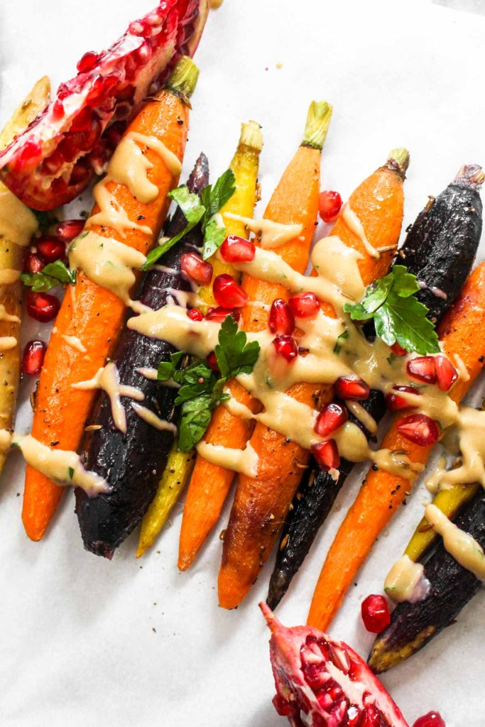 Maple Tahini Roasted Carrots - Whole roasted carrots drizzled in a maple tahini sauce