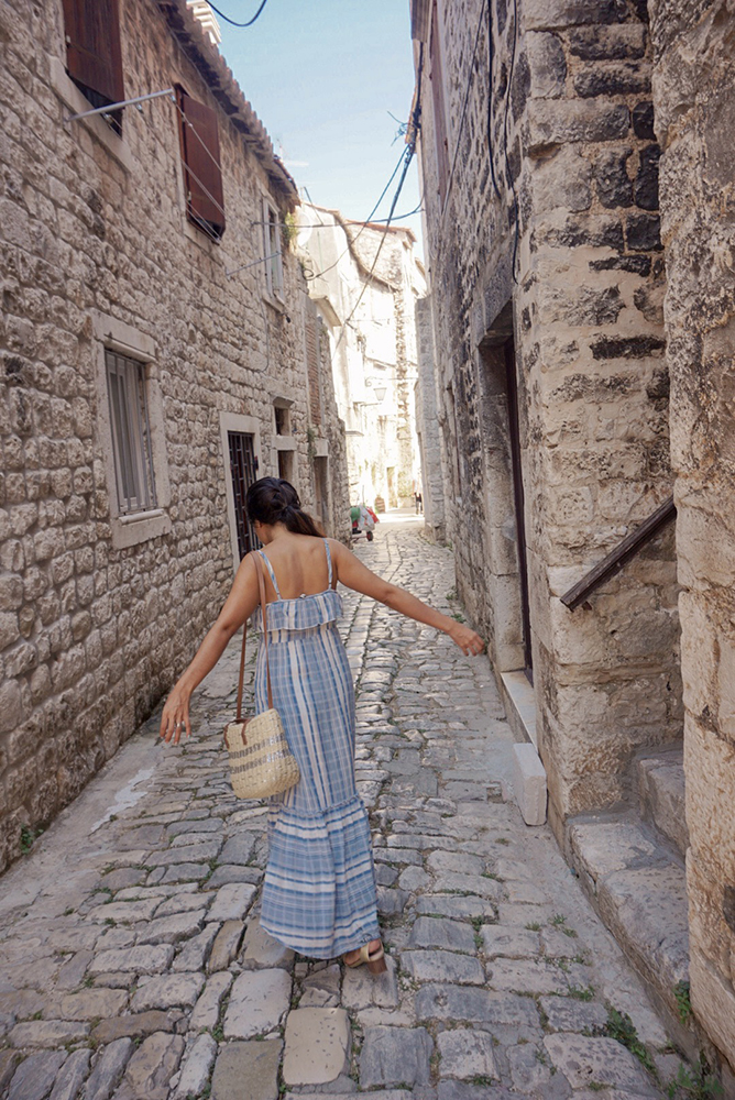 Walking on the pebbled streets of Trogir near Split