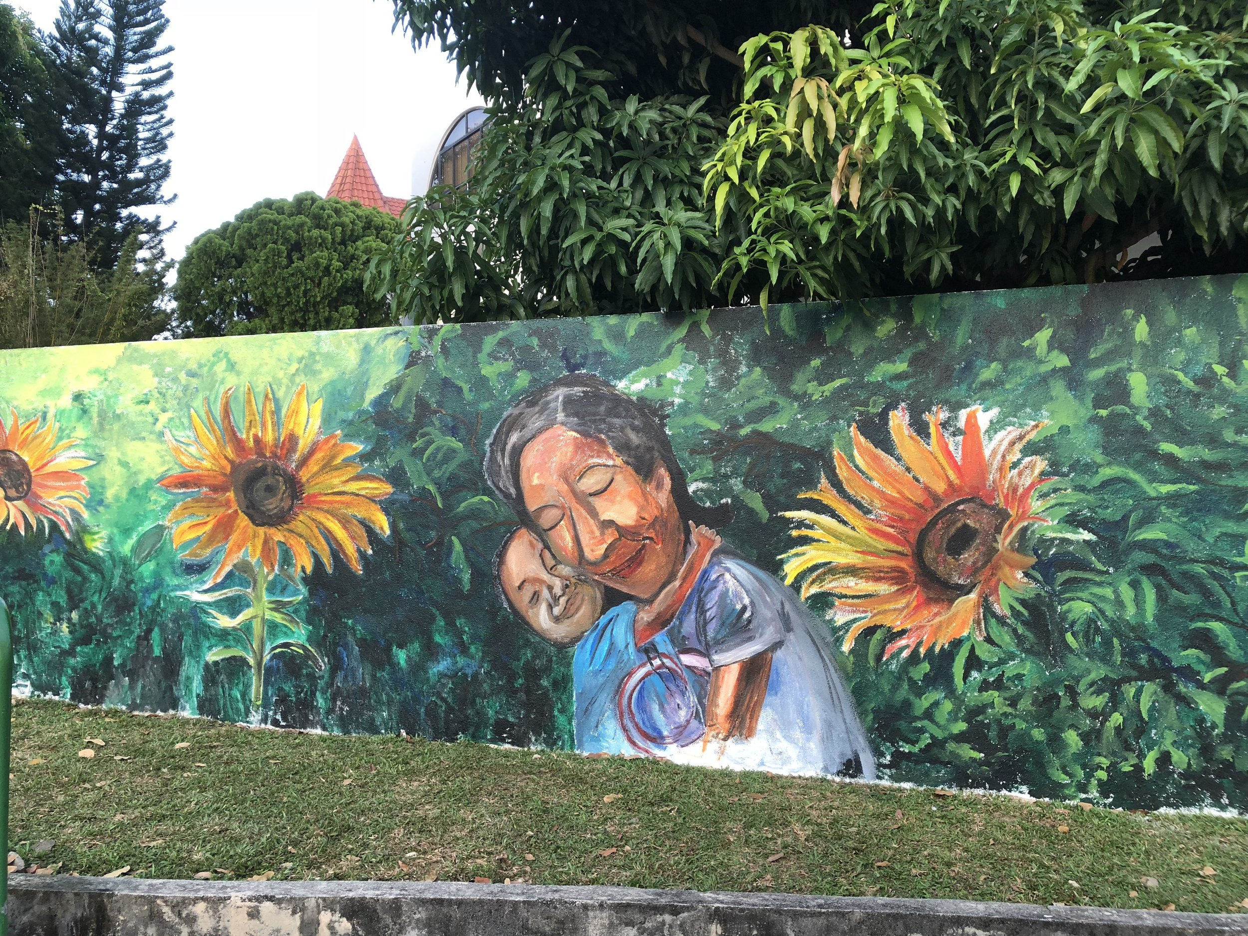 Hints of Van Gogh on second wall as well. Sunflowers signify Hope and they face the parent and the child here. I only added the sound of 3 in Cantonese means Life. To give this child a chance in Life.