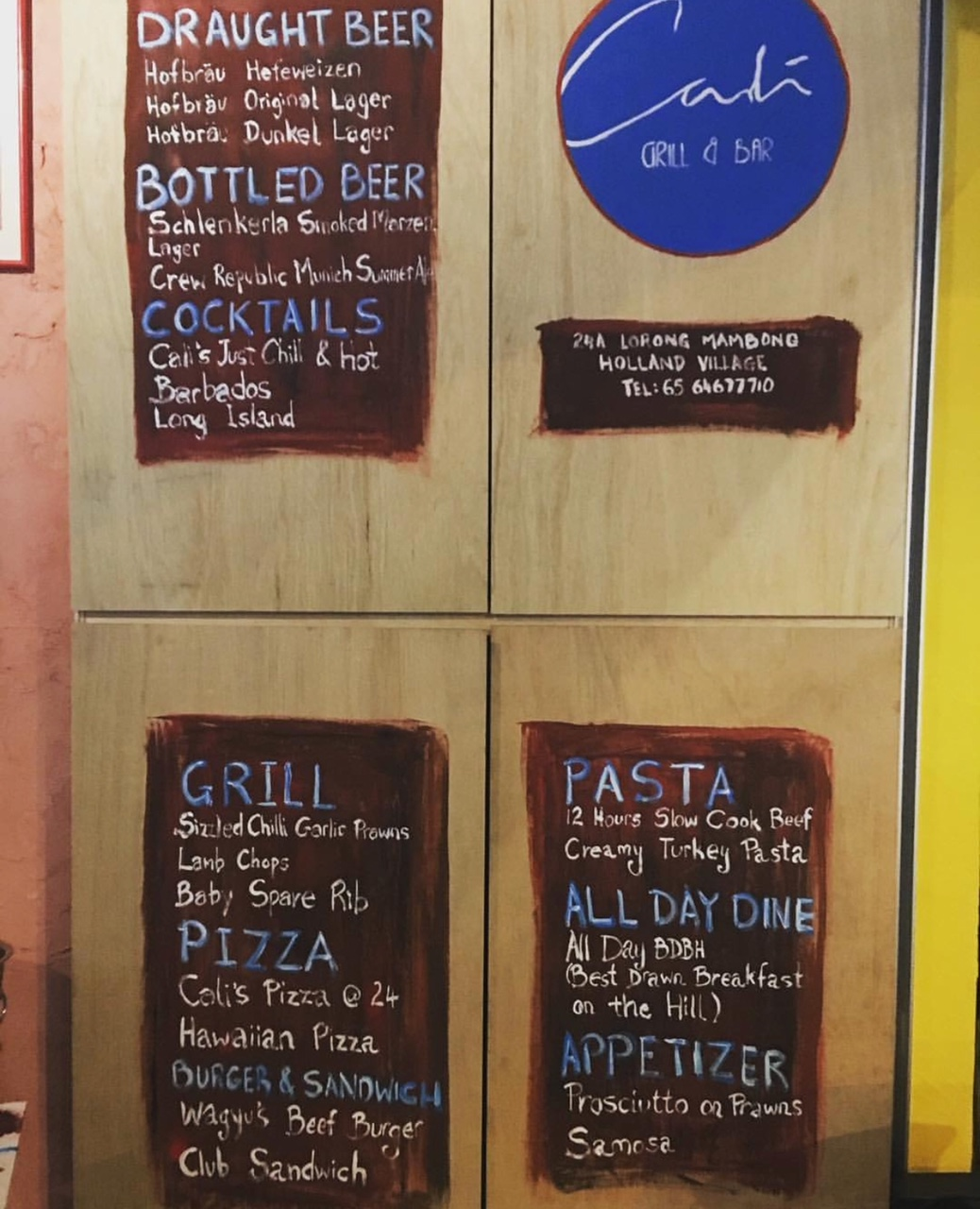 The handwritten menu on the wall with the daily offers.