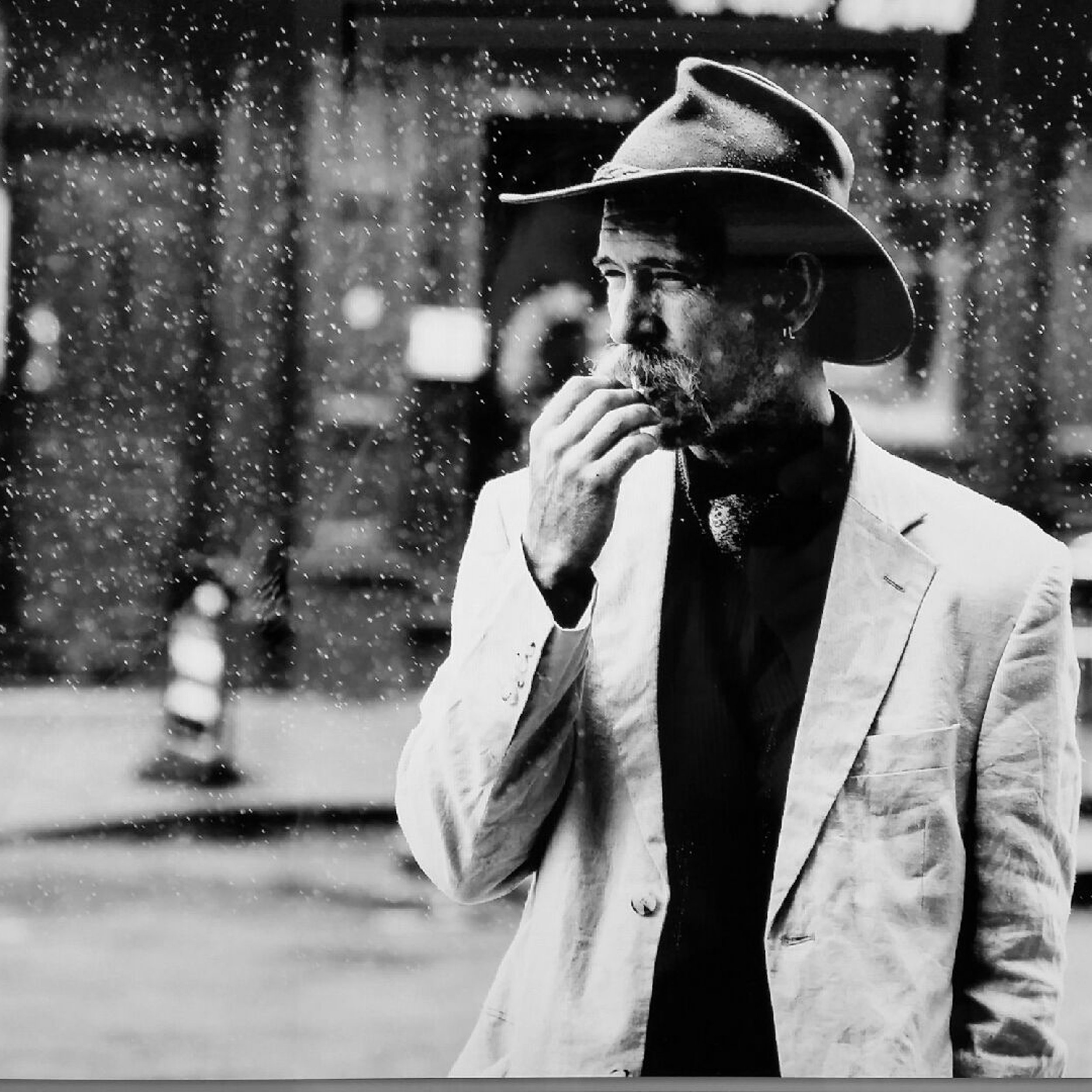Blues guitarist in the rain -  Manchester