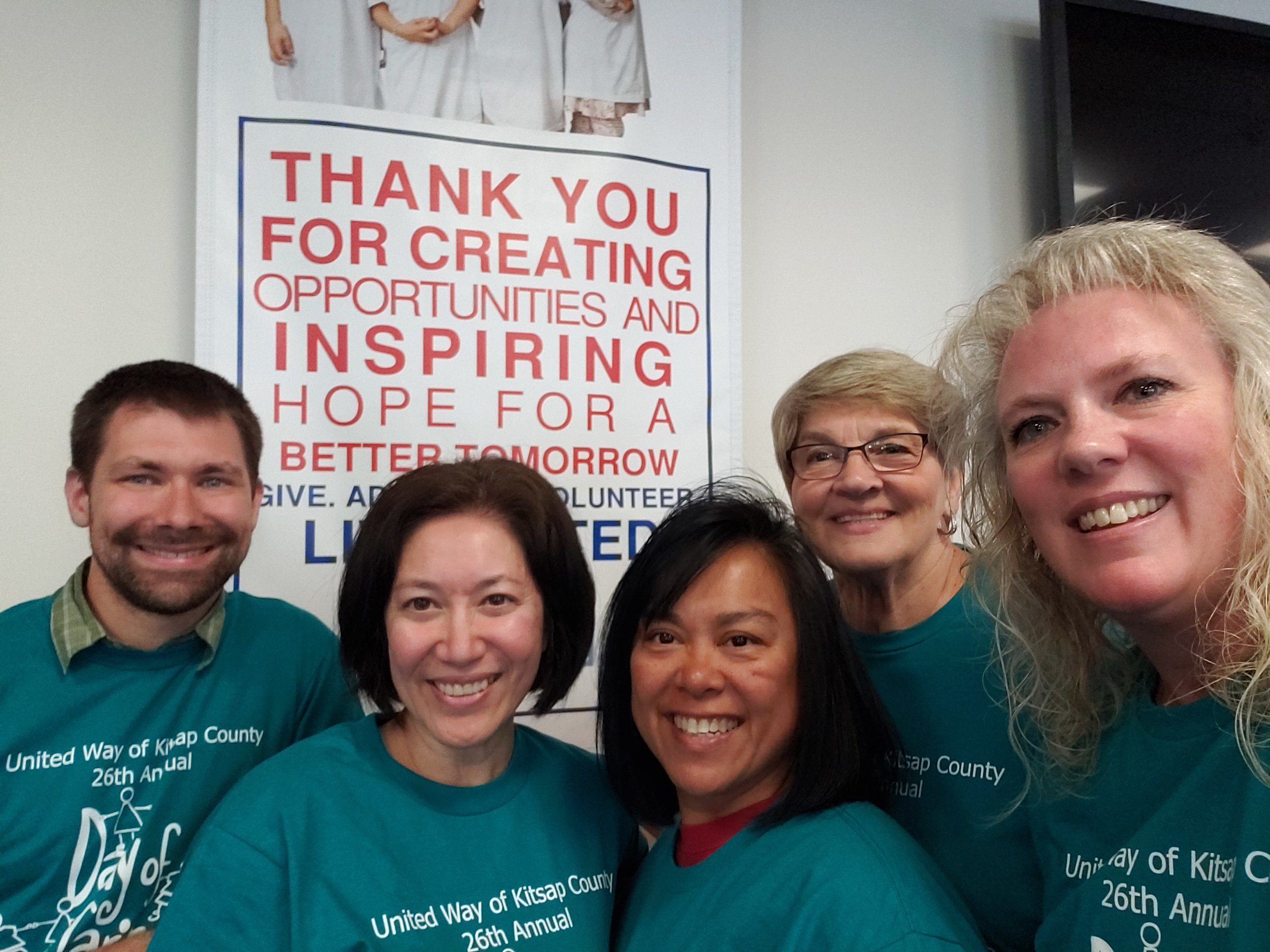 Anton with the amazing volunteers from Columbia Bank during a kit assembly party for the Kitsap County United Way's Day of Caring
