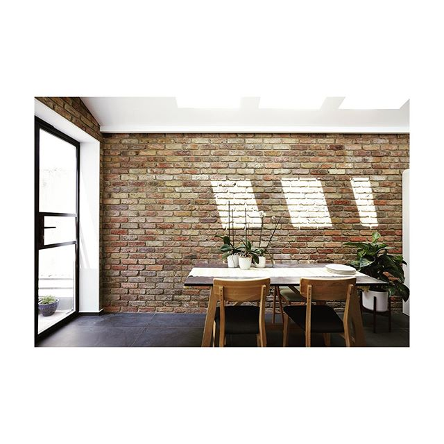 A sunny day in Stratford. The light paints constantly moving shapes on the brick in the dining area of our recently completed project in Stratford, East London. Full project is up on our site now 📸 by Rebecca Pierce #Stratford #refurbishment #dontmoveimprove #architect #londonarchitects