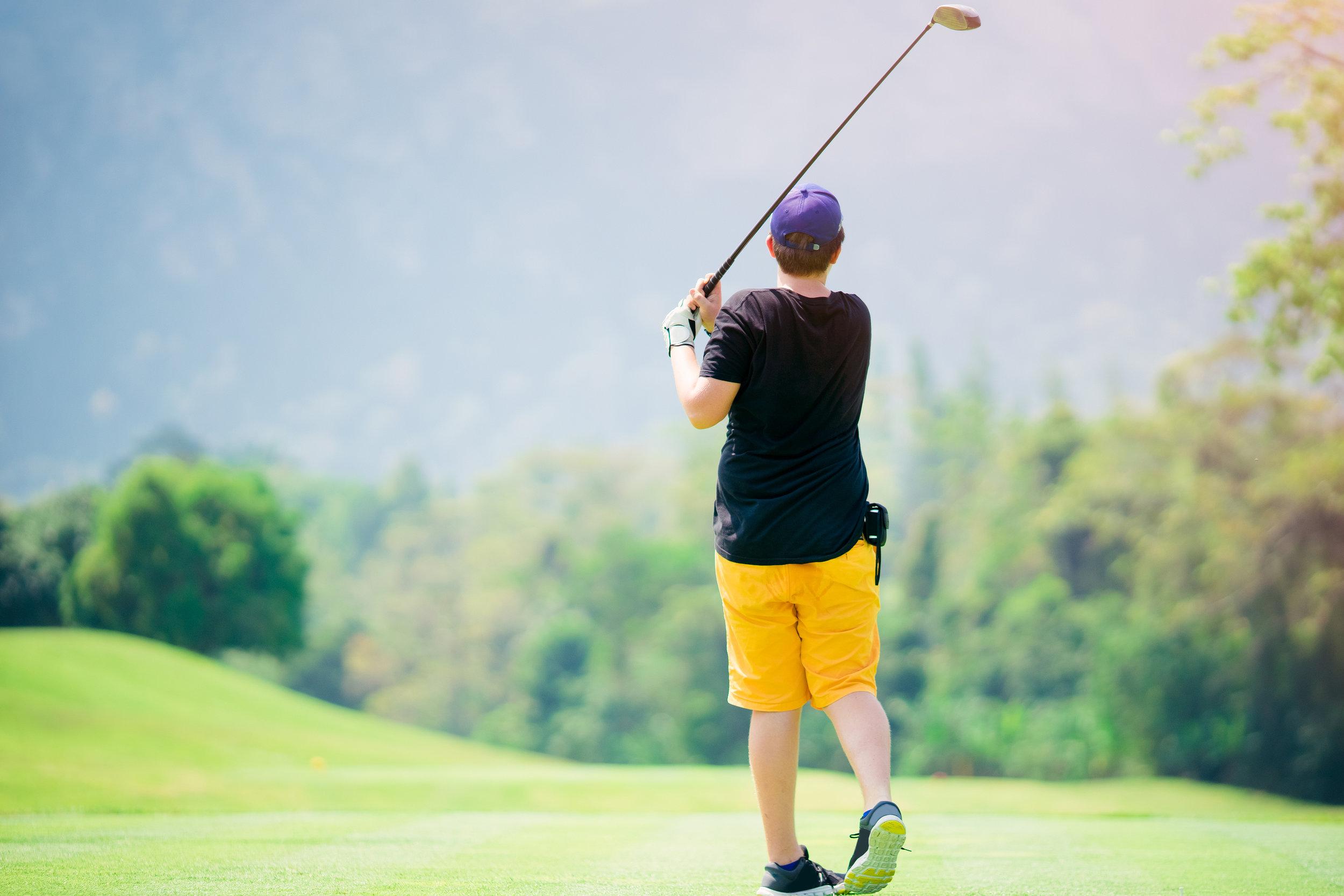 bigstock-Golfer-Hitting-Golf-Shot-With--221858920.jpg