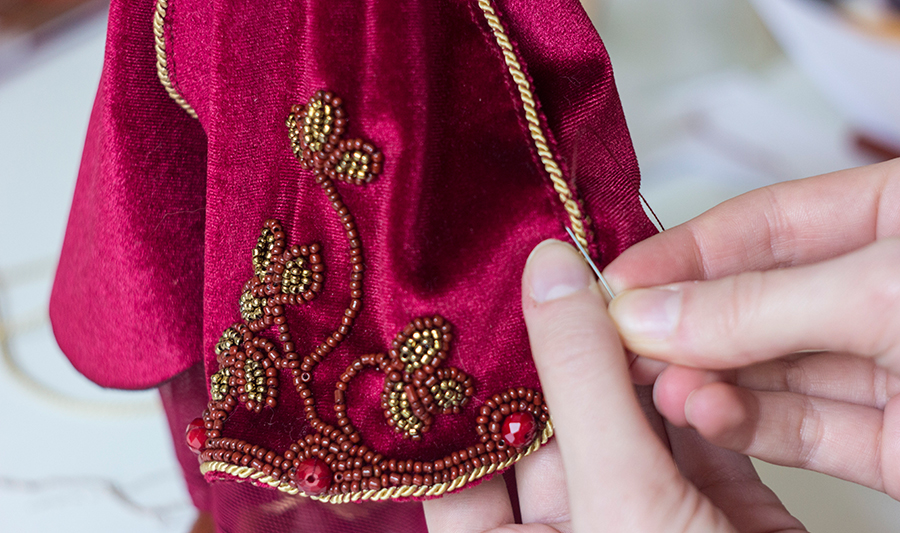 embroidering doll costume