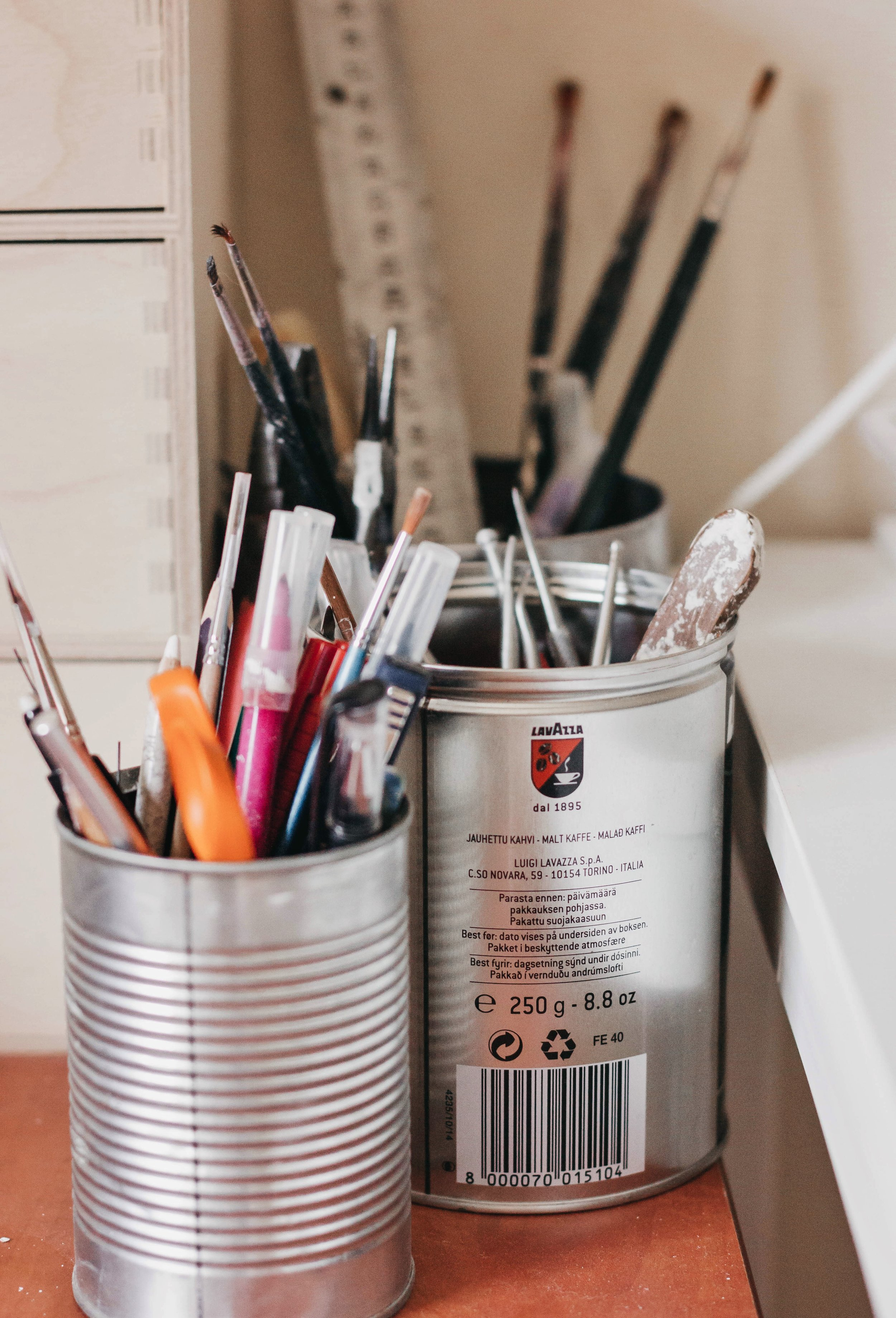 Reuse when possible! - These cans work very well holding my pens, brushes and sculpting tools.