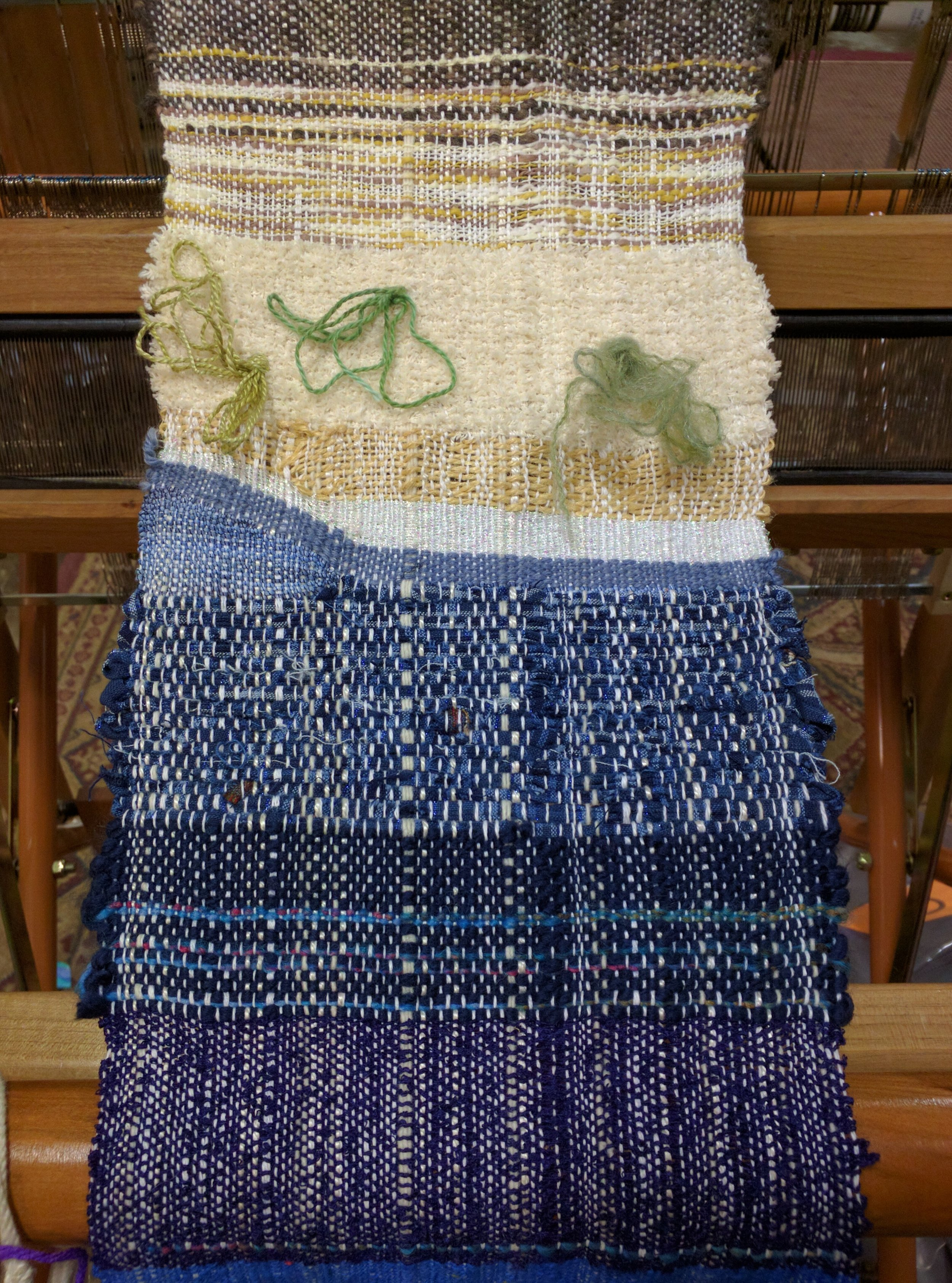 Part of a longer piece of nature-inspired tapestry weaving done on a self-wound warp and given to my late father, 2016.