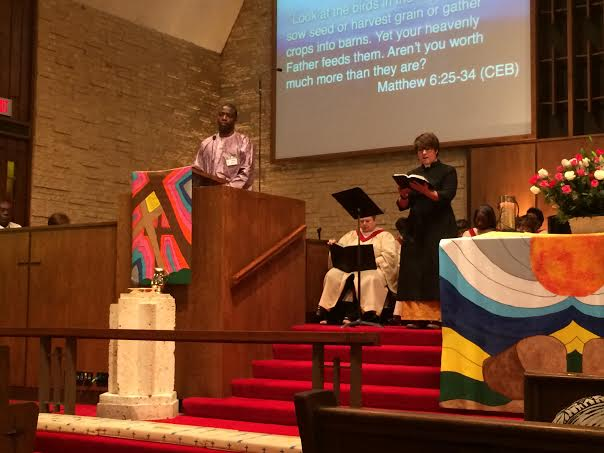 Thony Ngumbu preaches in Swahili and Rev. Hannah Terry preaches in English.