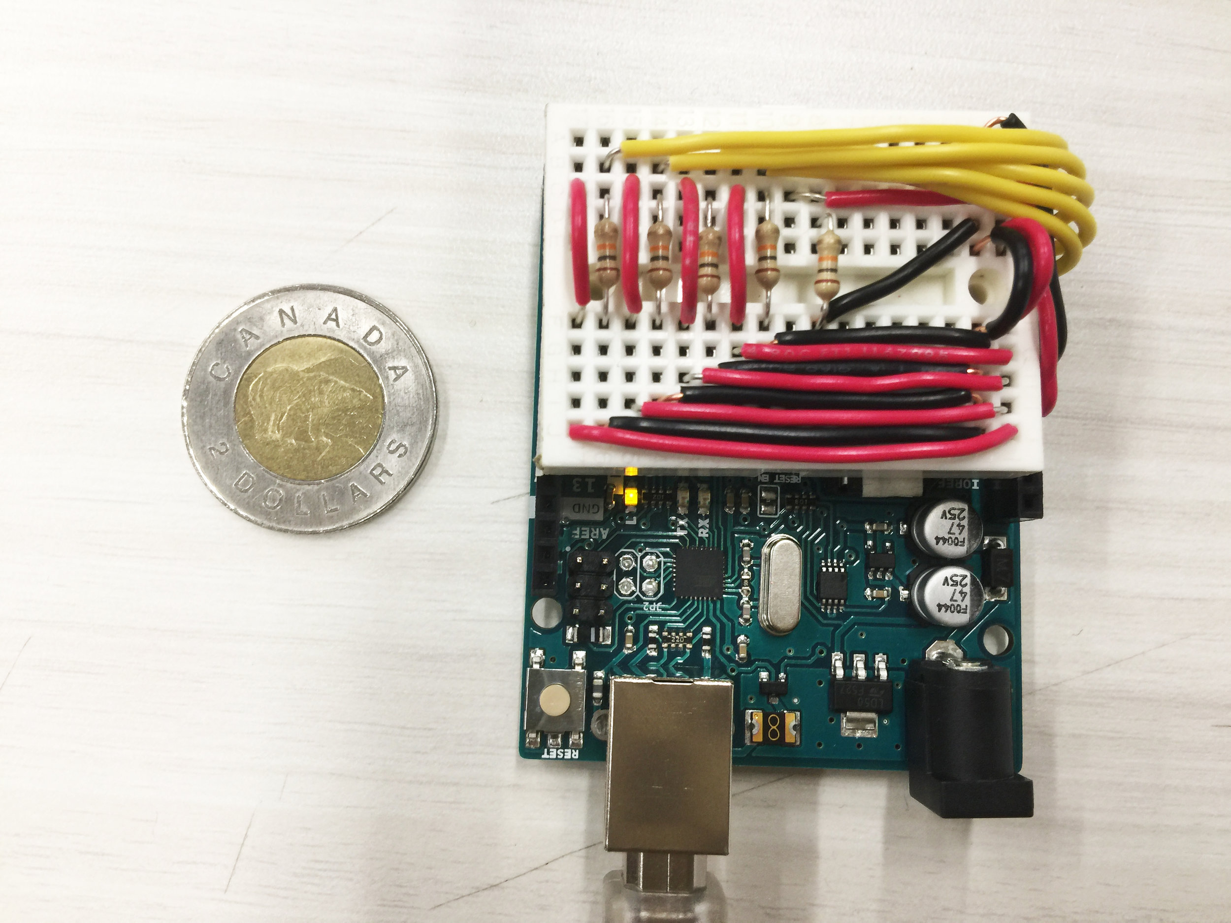 Wiring on the mini breadboard, toonie for size comparison