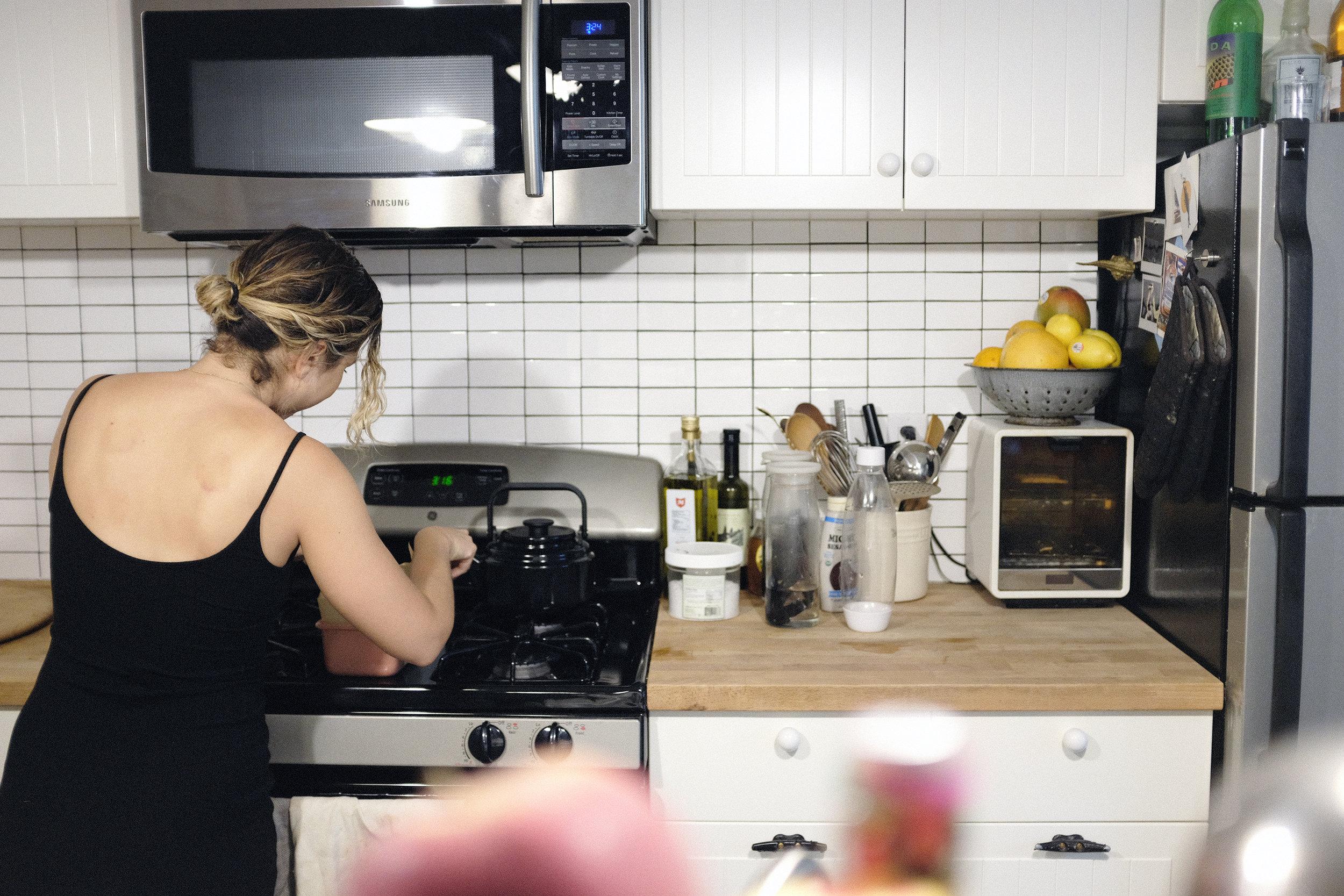 Mariela working in her kitchen