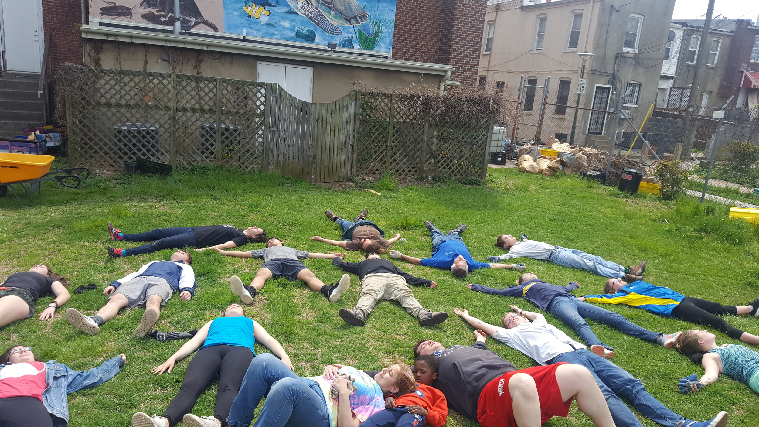 It is finished! UCC Norwell takes a rest to soak up the sun and take a breath on the last day of service at Amazing Grace Lutheran Church in McElderry Park, Baltimore, Maryland. Photo: Mel Lowry