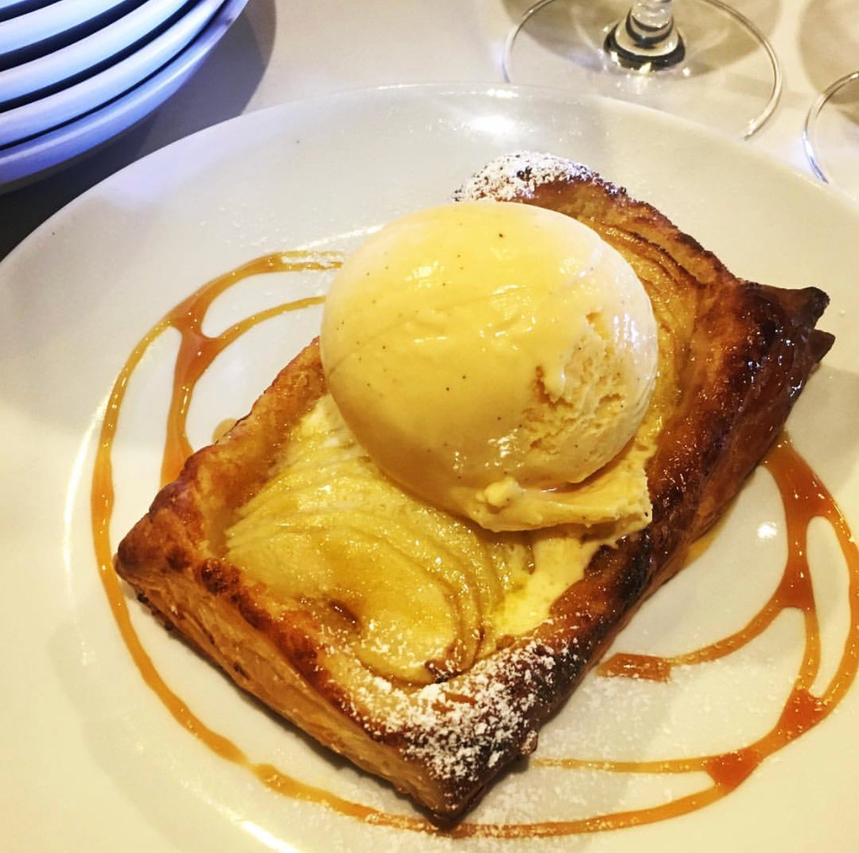 Baked Apple Flan frangipane, vanilla bean ice cream.  Image courtesy of Woodland Kitchen & Bar.