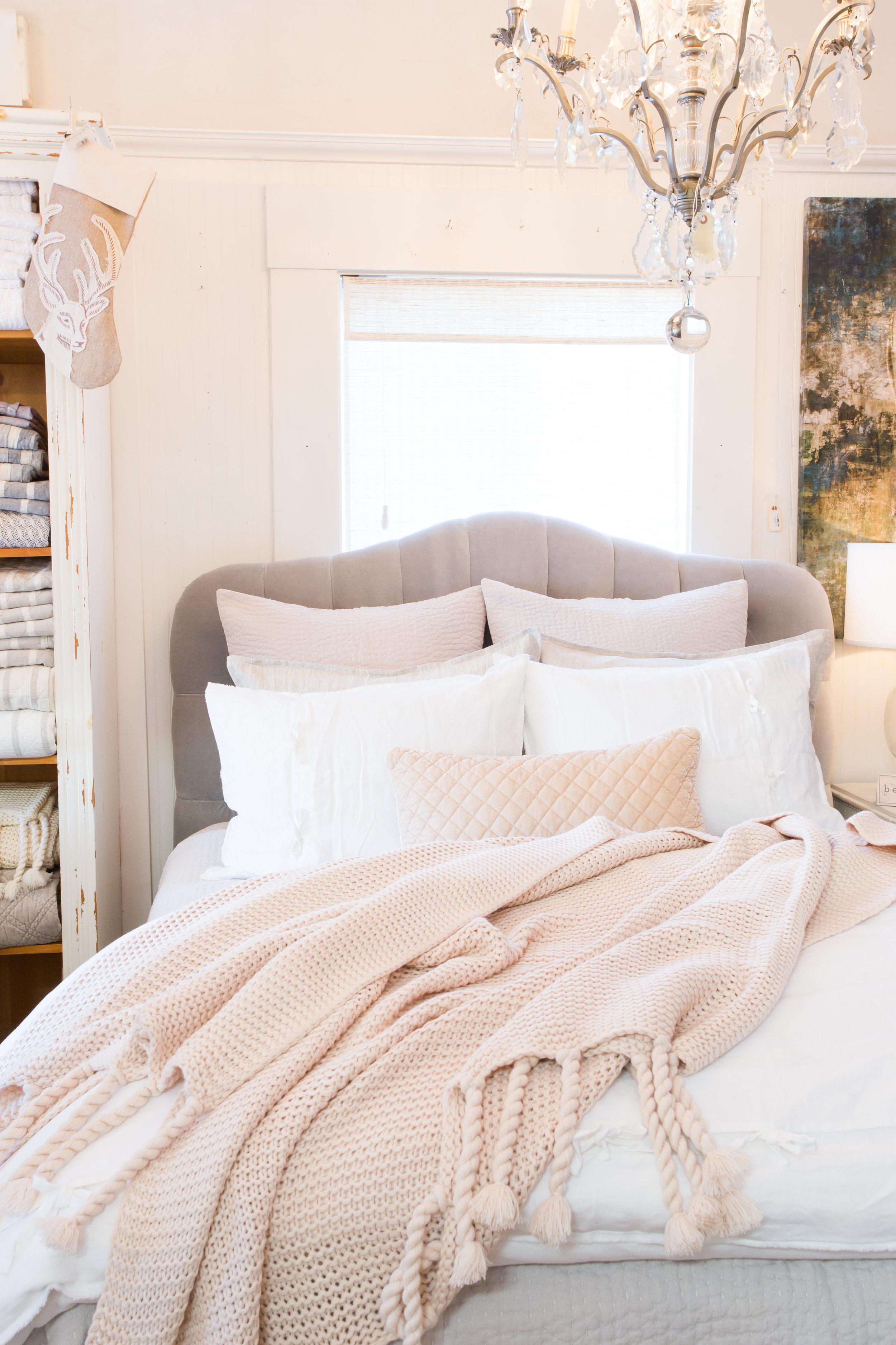 Cream bedding, blush coverlet