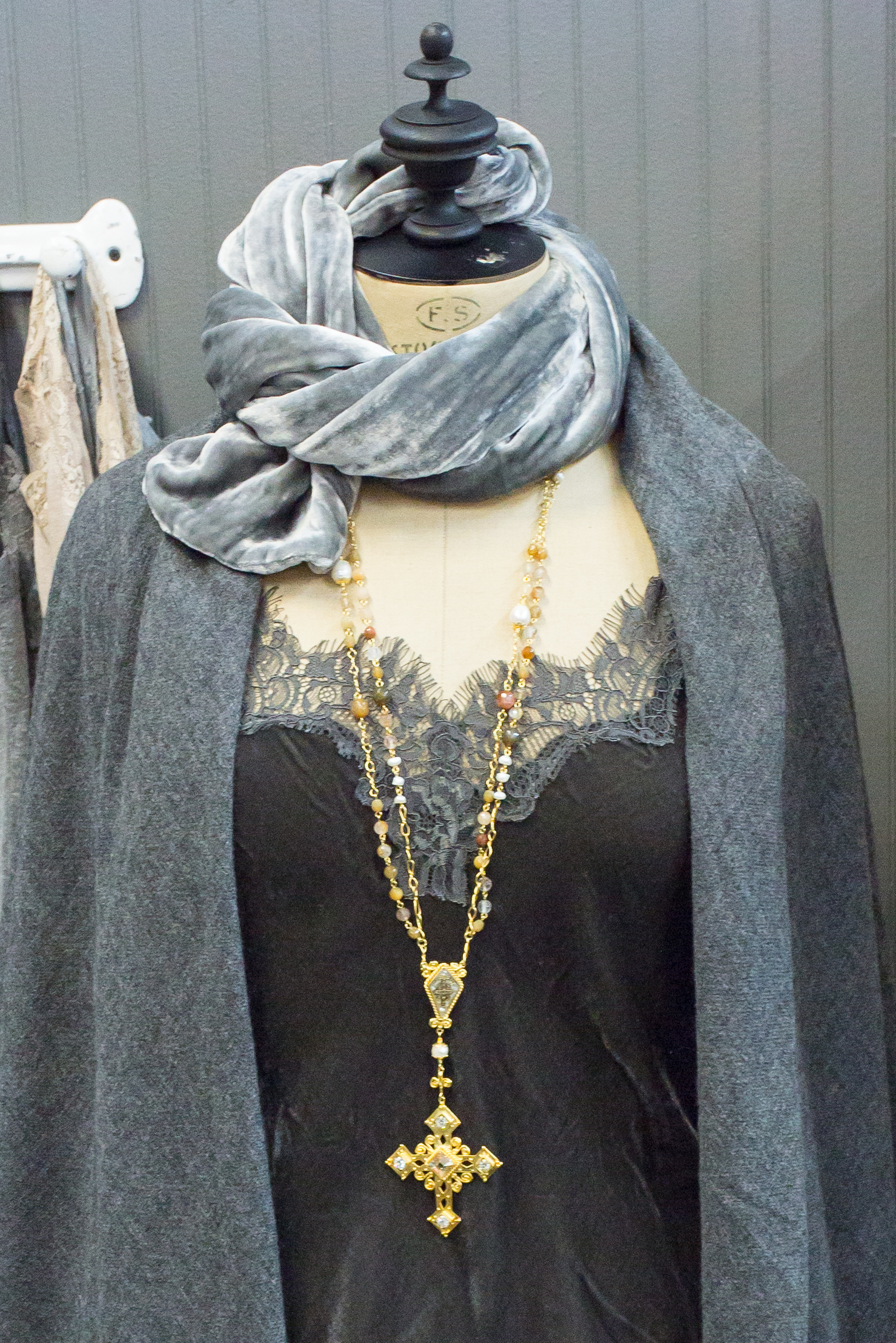 Navy cardigan styled with gold jewelry